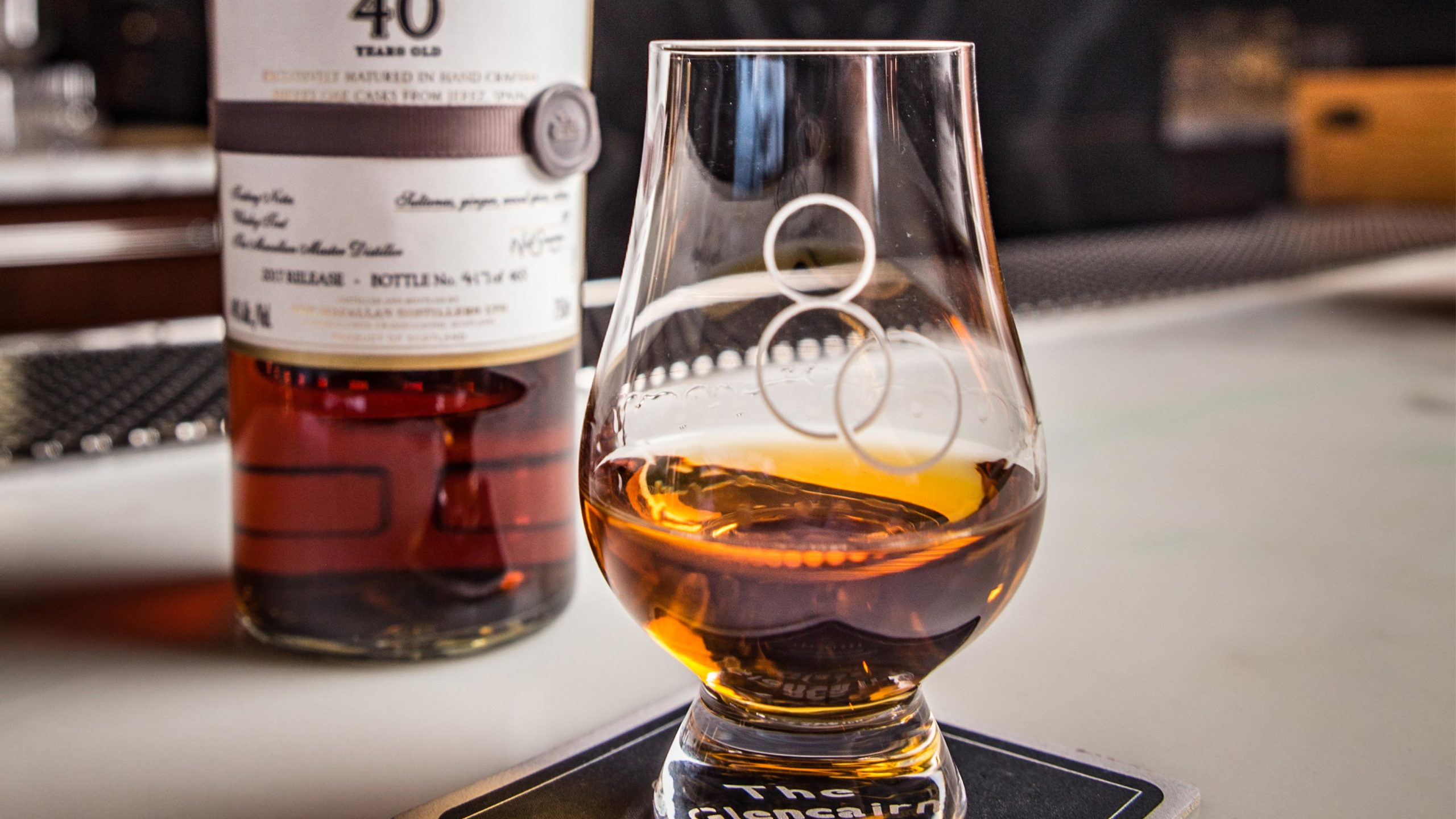 A photo of whisky in a scotch 80 glass